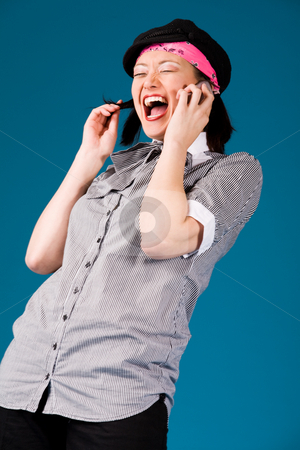 Young asian girl on the phone stock photo, Young asian girl is calling and laughing by Frenk and Danielle Kaufmann