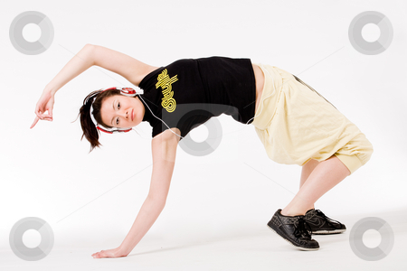 Bending backward stock photo, Young girl enjoying the music and dance on it by Frenk and Danielle Kaufmann