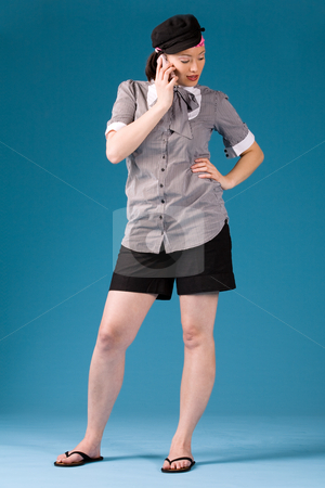 Calling my friends stock photo, Young asian girl is calling and standing. Full body photogrphed by Frenk and Danielle Kaufmann