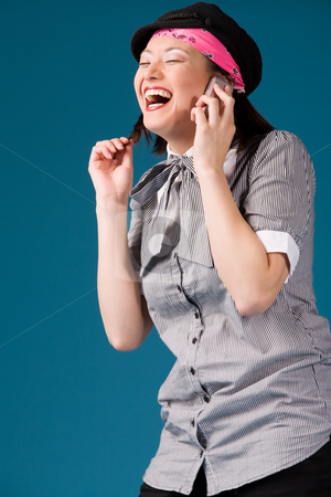 Have fun with my phone stock photo, Young asian girl is calling and laughing by Frenk and Danielle Kaufmann