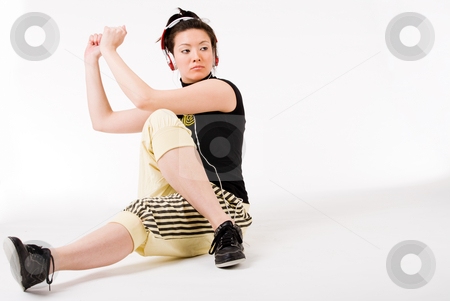 Sitting and dancing on my favourite music stock photo, Young girl enjoying the music and dance on it by Frenk and Danielle Kaufmann