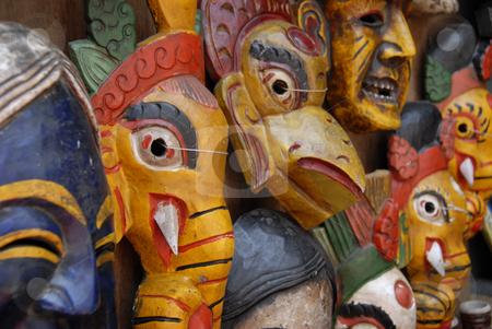 Nepalise Masks stock photo, Masks on display in a Kathmandu, Nepal marketplace by A Cotton Photo