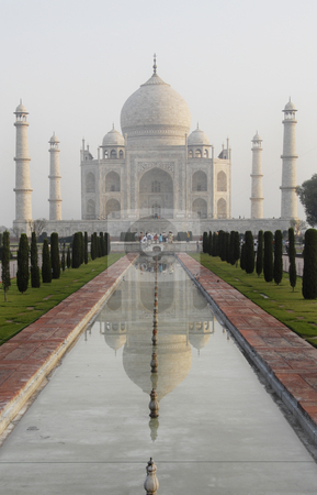 Taj Mahal in India stock photo, Classic view of the Taj Mahal in Agra, India.  Showing the main mausoleum, the domes and minarets as well as the reflection across the pool and the sculptured garden. by A Cotton Photo