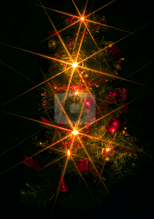 Christmas Tree stock photo, A christmas tree with electric candles on the black background by Petr Koudelka