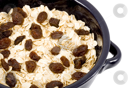 Bowl of Oatmeal stock photo, A bowl of oatmeal with raisins - healthy diet by Petr Koudelka