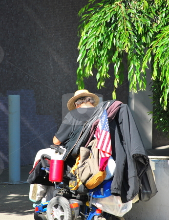 Homeless Veteran stock photo, Homeless veteran disable in a wheelchair out on the streets. by OSCAR Williams