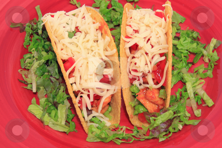 Taco stock photo, Taco and lettuce on red plate by Jack Schiffer