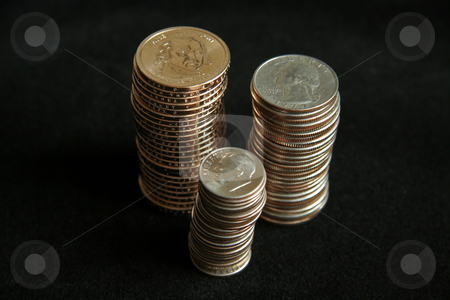 Stack of Coins stock photo, Multiple stacks of United States coins by Kevin Tietz