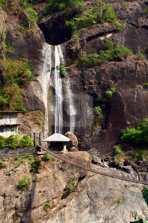 Waterfalls stock photo, Overlooking waterfalls with hanging bridge beneath by Jonas Marcos San Luis