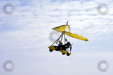 Ultralight aircraft stock photo, Side-view of an ultralight aircraft against a blue sky by Jonas Marcos San Luis