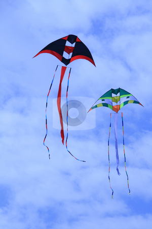 Kites stock photo, Two giant colorful kites flying against a blue sky by Jonas Marcos San Luis