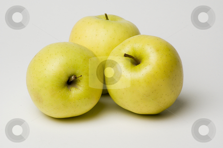 Apples stock photo, Three yellow apples on a white background by Vlad Podkhlebnik