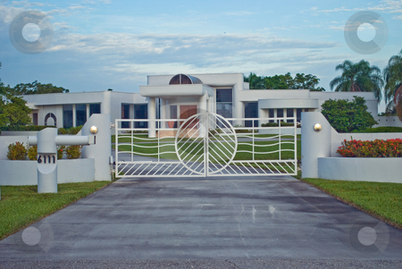 Modern Gated House stock photo, A modern suburban gated house by Robert Cabrera