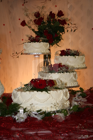 White and Red Wedding Cakes stock photo, Four tiers of a wedding cake by Debbie Hayes