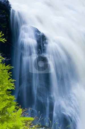Waterfall stock photo, Waterfall in a rocky canyon by Vlad Podkhlebnik