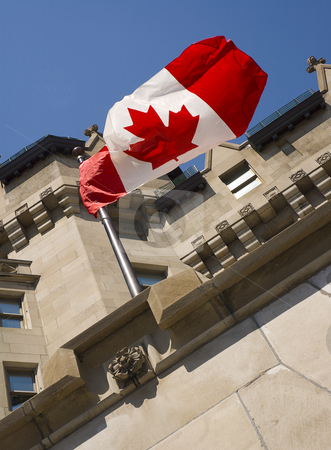 Canadian Flag stock photo, Building with the Canadian flag in the wind by Vlad Podkhlebnik