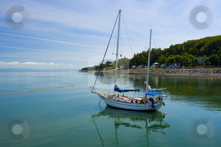 Sail boat stock photo, Sail boat on a calm river by Vlad Podkhlebnik