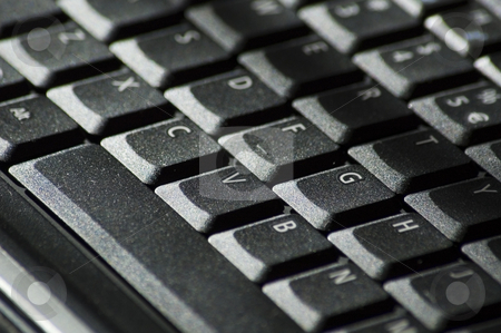 Computer keyboard stock photo, Black computer keyboard showing a few letters in closup by Vlad Podkhlebnik
