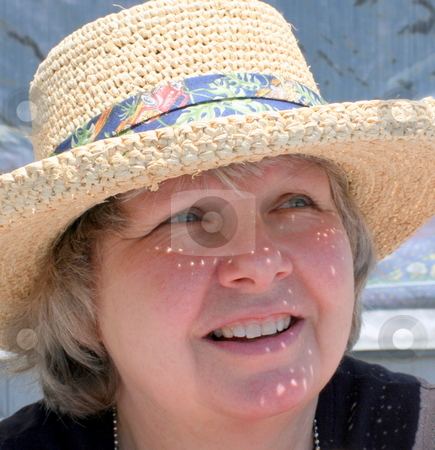 Woman in Hat,  Protected from Sun stock photo, Woman wearing sun hat, protected from the bright sun by Tom and Beth Pulsipher