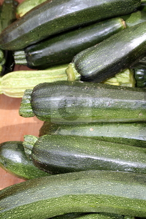 Group of zucchini stock photo, Just picked young zucchini, at a farmers' market by Tom and Beth Pulsipher