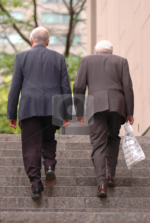 People stock photo, Two old business man walking up the stairs by Vlad Podkhlebnik