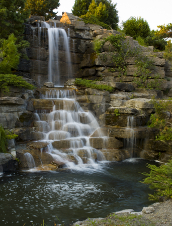 Waterfall stock photo, Waterfall at the botanical garden of Montreal city by Vlad Podkhlebnik