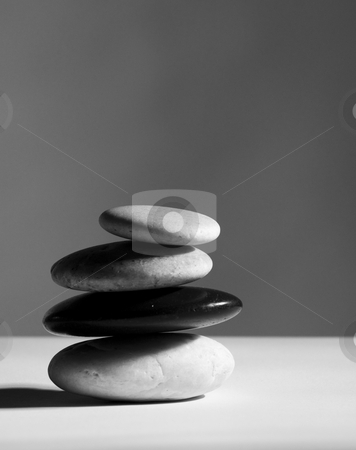 Rocks stock photo, A stack of four diffent rocks on a table by Vlad Podkhlebnik