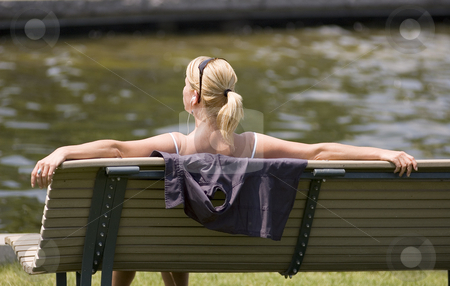 Lady stock photo, Lady sitting on a bench and listening music by Vlad Podkhlebnik