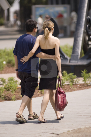 Couple stock photo, A couple walking on the street and holding each other by Vlad Podkhlebnik