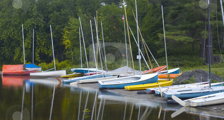 Boats stock photo, A bunch of boat coasted on the sand by Vlad Podkhlebnik