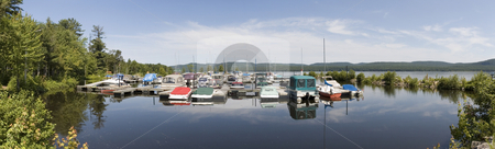 Boats stock photo, Panoramic view of boat docked at a marina by Vlad Podkhlebnik