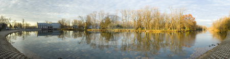 Panoramic view stock photo, Panoramic view of a lake and a park by Vlad Podkhlebnik