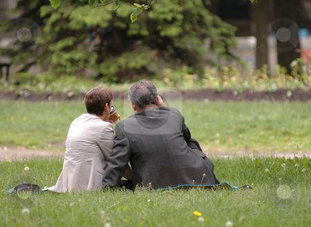 People stock photo, Couple of workers having lunch in a city park by Vlad Podkhlebnik