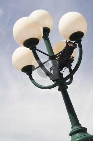 Lamp stock photo, Close up view of a city lamp with a blue sky by Vlad Podkhlebnik