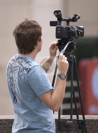 Working stock photo, A man working with his video camera by Vlad Podkhlebnik