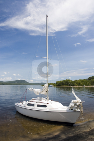 Single Sailboat stock photo, A small white sail boat near the shore by Vlad Podkhlebnik