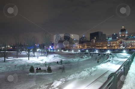 Cityscape stock photo, People skating outside at night by Montreal city by Vlad Podkhlebnik