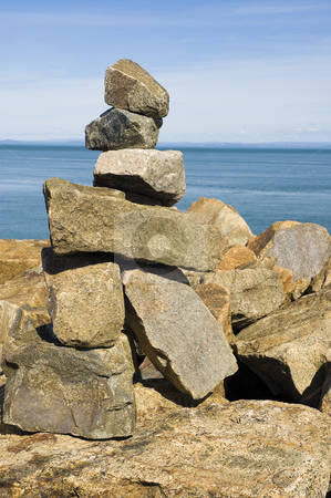 Rock statue stock photo, A rock statue built near the ocean by Vlad Podkhlebnik