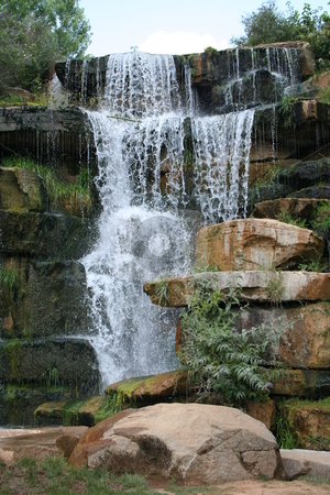 Falling water stock photo, Man made waterfall in Spring Park in Tuscumbia, Alabama by Debbie Hayes