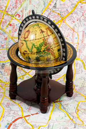 Globe on a map stock photo, An old globe standing on a map - close up by Petr Koudelka