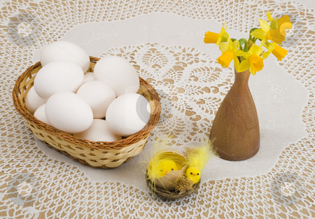 Easter stock photo, A basket of eggs, easter chicken and yellow daffodils by Petr Koudelka
