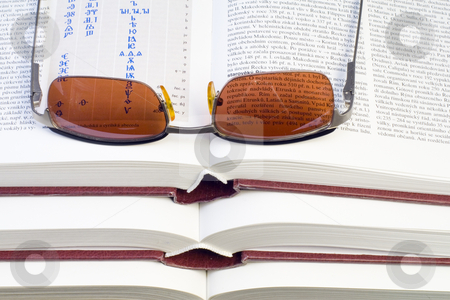 Glasses on Books stock photo, Glasses lying on the pile of books - close up by Petr Koudelka