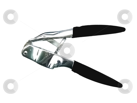 Garlic Press stock photo, A black garlic press you can find in most kitchens. by Petr Koudelka