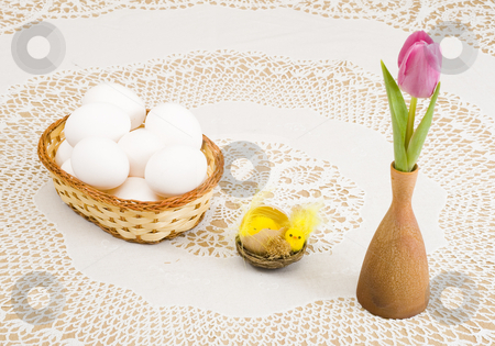 Easter stock photo, A basket of eggs, easter chicken and a pink tulip by Petr Koudelka