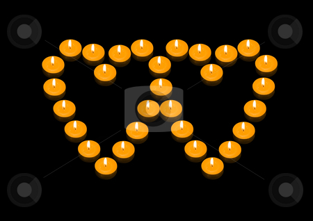 Fiery Hearts stock photo, A group of burning candles forming two joint fiery hearts by Petr Koudelka
