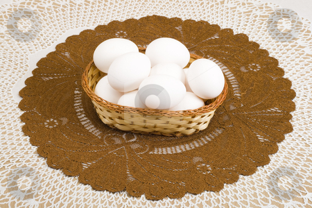 White Easter Eggs stock photo, A basket of white eggs on the brown tablecloth by Petr Koudelka