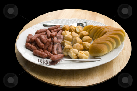Cheese and Sausages stock photo, A plate of cheese and sausages - close up by Petr Koudelka