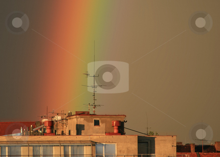 Rainbow stock photo, A part of a rainbow over the roof of a block in the city of Prague by Petr Koudelka