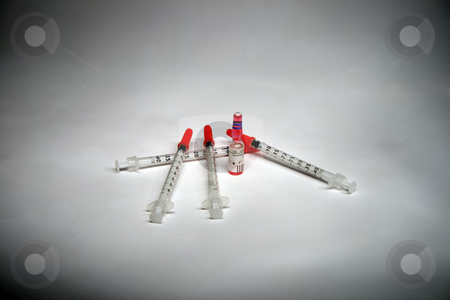 Syringes and Phial stock photo, Group of clinical syringes and a phial - close up by Petr Koudelka