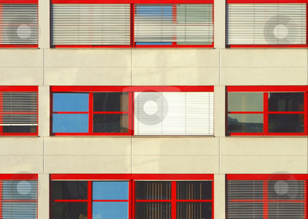 Rows of Windows stock photo, Three lines of red windows in an office building by Petr Koudelka